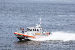 Fast boat with gunner of U.S. coast guard. Speeding boat with gunner ready to fire of U.S. coast guard Stock Photography