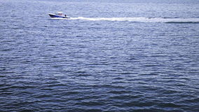 Fast boat in the middle of the Ocean stock video