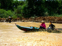 Fast boat on the muddy waters. Fast boat on the Mekong delta stock photography