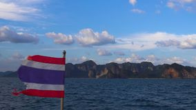 Fast Boat with National Flag of Thailand is Coming to Rocky Shore in Krabi, Thailand. 4k UHD stock video