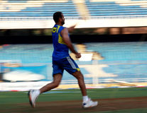 Fast bowler cricket. A fast bowler, Irfan Pathan, practices before a match royalty free stock image