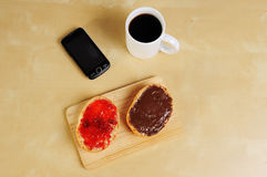Fast breakfast with bread roll cup of coffee Stock Photos