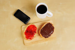 Fast breakfast with bread roll cup of coffee Royalty Free Stock Images