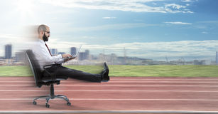Fast business - businessman sitting royalty free stock photography