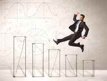 Fast business man jumping up on hand drawn charts Royalty Free Stock Photo