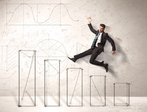 Fast business man jumping up on hand drawn charts Stock Image