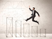 Fast business man jumping up on hand drawn charts Stock Images