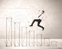 Fast business man jumping up on hand drawn charts Royalty Free Stock Image