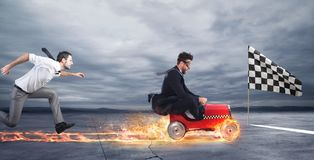 Fast businessman with a car wins against the competitors. Concept of success and competition stock photo