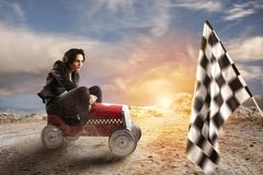 Fast businesswoman with a car wins against the competitors. Concept of success and competition. stock images
