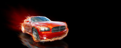 Fast car. A rust colored sporty car speeds down a dark black speedway. This is a dodge charger with a hemi engine
