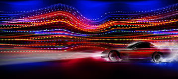 Fast car. A fast sports car speeding past night florescent lights Royalty Free Stock Photo