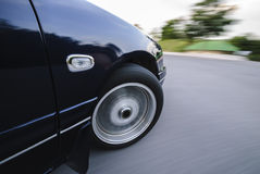 Fast car. Moving forward with blurry bakcground Stock Images