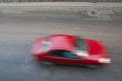 Fast Car. Going on the street with motion blur Stock Photos