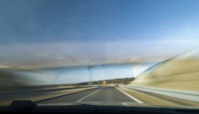 Fast car. A view through the windscreen of a speeding car, motion blur stock photo