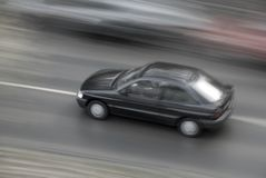 Fast car. A fast moving black car Royalty Free Stock Images