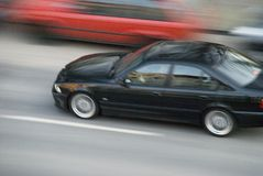 Fast car. A fast driving black car Royalty Free Stock Image