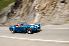 Fast car. Moving with motion blur Royalty Free Stock Images