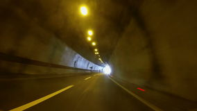 Fast Car driving through tunnel stock footage