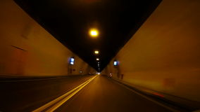 Fast Car driving through tunnel ucka, Croatia stock video footage