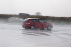 Fast car induced aquaplanning during course of advanced driving Royalty Free Stock Photography