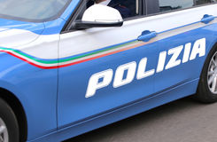 Fast car of the Italian police with great POLICE written. Fast car of the Italian police with big POLICE written on city streets Stock Image