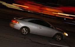 Fast car motion blur. Panning motion blur shot of a car at night Stock Photos