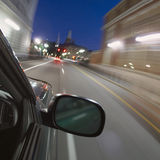 Fast car moving. In motion in city traffic Stock Images