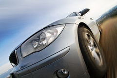 Fast car moving with motion blur stock photography