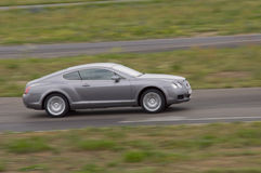 Fast car in a race. Fast grey car in a race Stock Photography
