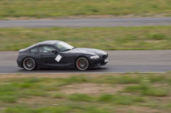 Fast car in a race. Fast black car in a race Stock Photography