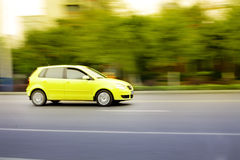 Fast car on road. Fast yellow car motion blur Stock Photo