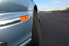 Fast Car Speeding on a Road with Real Motion Blur royalty free stock image