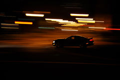 Fast car. A car speeds through the streets of Honolulu, Hawaii at night Stock Photos
