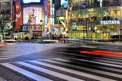 Fast car in the street of shibuya , tokyo , japan. Taken at a low exposure speed, the motion of the cars  moving across  the street during the night in a city Royalty Free Stock Photography