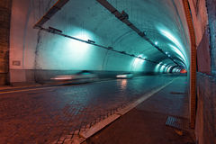 Fast car in urban tunnel Stock Image