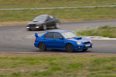 Fast cars in a race Royalty Free Stock Photography