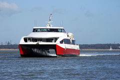 Fast catamaran on the Solent. A catamaran fast passenger ferry underway on the Solent Royalty Free Stock Image
