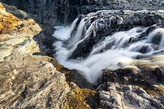 Fast, Cold Runoff Waterfalls in the Rocky Mountains royalty free stock photo