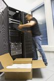 Fast IT Consultant install a router or server Stock Photos