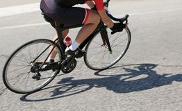 Cyclist over a black bike during the curve Stock Images