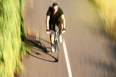 Fast cyclist riding in forest - aerial above view Stock Photo