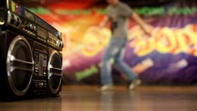 Fast-dancing top-rock legs. A breakdance steps on the background of graffiti and a cool boobox stock video footage