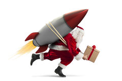 Fast delivery of Christmas gifts ready to fly with a rocket isolated on white background. Santa Claus with gift box ready to fly with a rocket in the sky Royalty Free Stock Photos