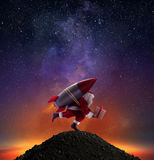 Fast delivery of Christmas gifts ready to fly with a rocket Royalty Free Stock Photography
