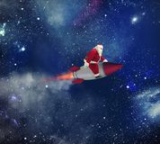 Fast delivery of Christmas gifts with Santa Claus in the space stock photo