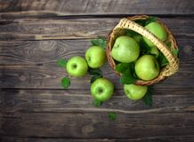 Fast delivery of fresh fruits. Basket of apples on a wooden background. Flat- lay. Top view. stock photos