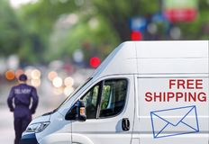 Fast delivery, van on city street blured bokeh background Royalty Free Stock Image