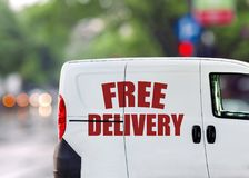 Fast delivery, van on city street isolated green blured background Stock Photos