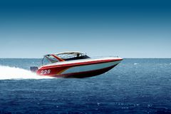 Fast drive!. Speedboat cruising in the sea Stock Photos